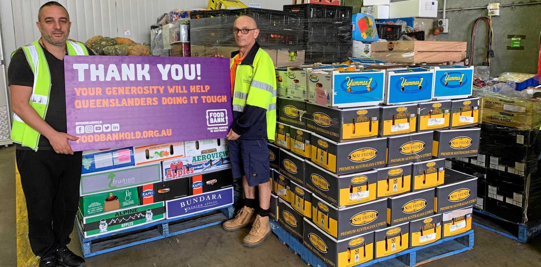 Fruit shop owner Habib Habchi with Food Bank logistics manager Dave Jackman.
