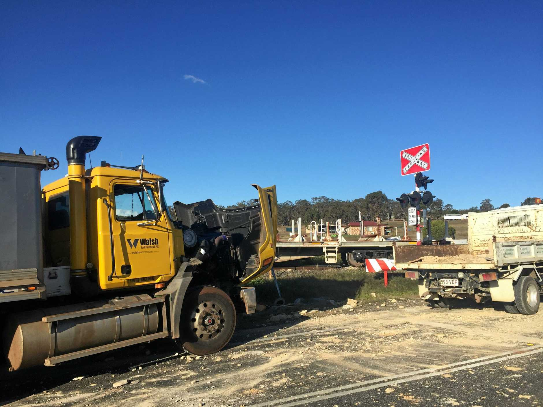 CRASH: Train collides with sandstone truck