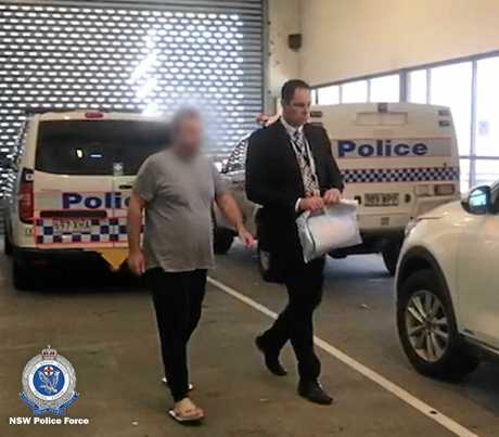 The man being escorted to Tweed Heads Police Station