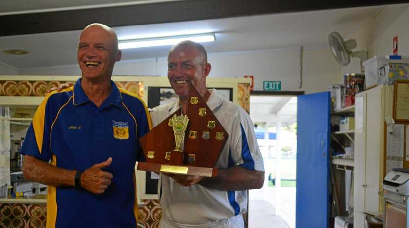 GRINNING WINNER: Open Singles champion Troy McCallum with runner-up Nick Smith.