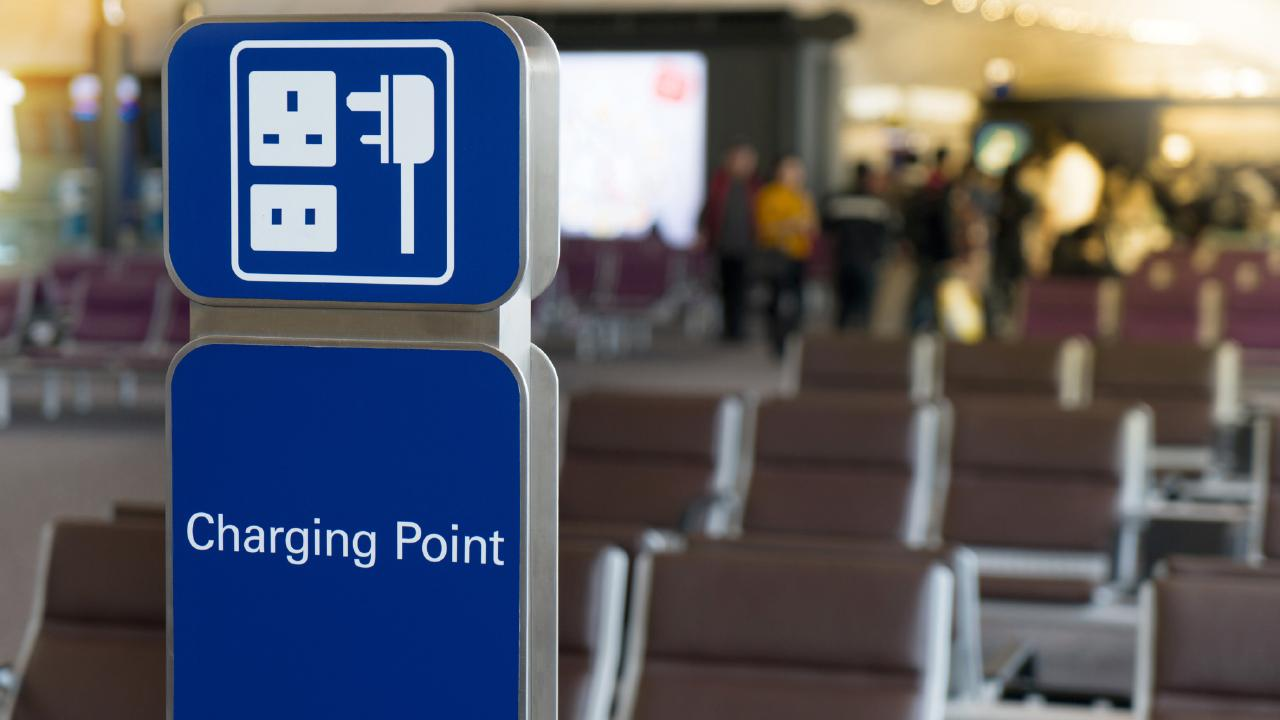 A free charging station at an international terminal airport for passengers to use.