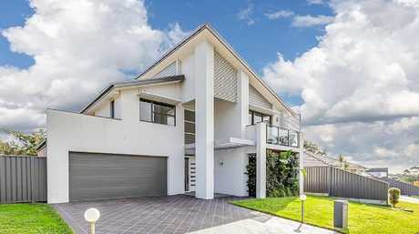 A house in the outer Newcastle suburb of Fletcher with a price guide of $800,000-$850,000.