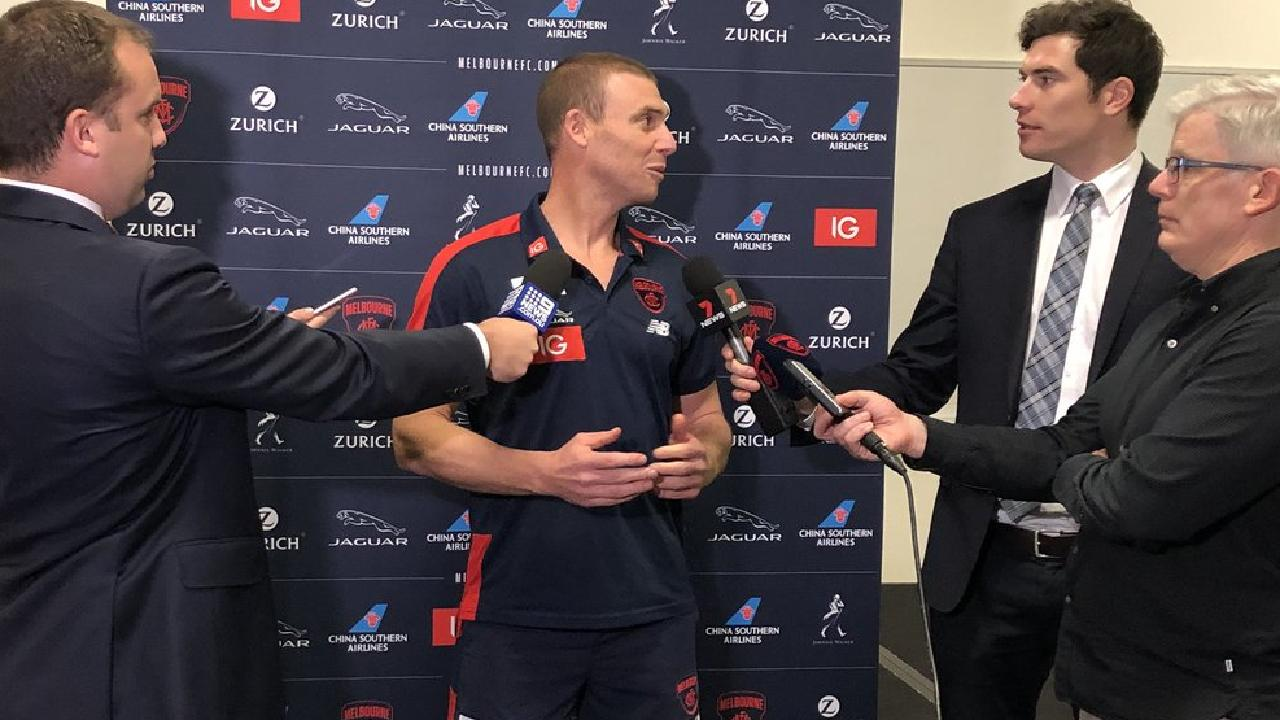 Simon Goodwin was pictured by the Melbourne Demons on social media just moments before he walked away from his scheduled press conference.