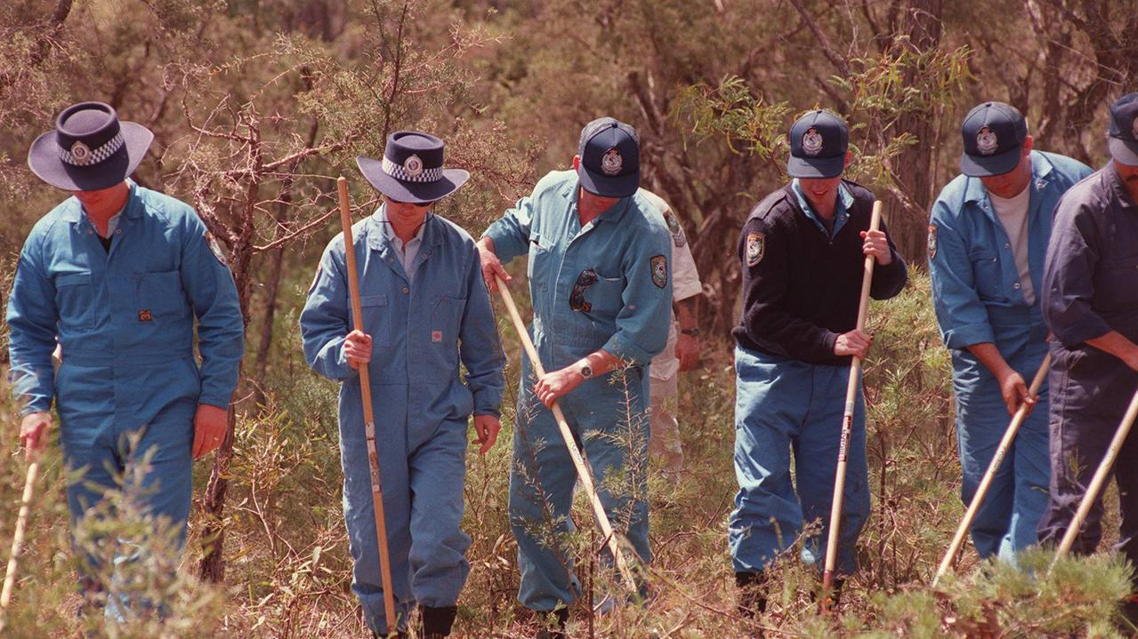Police search Belanglo State Forest National Park in 1993 after the remains of backpackers were found.