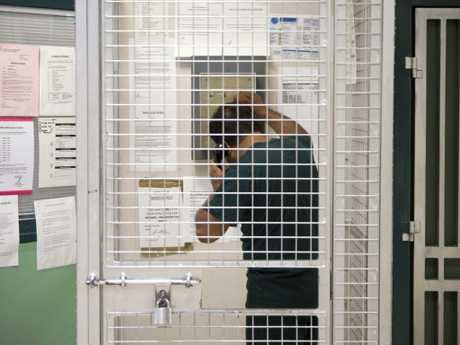 An inmate uses the phone in a unit inside the Goulburn Supermax prison where Milat was until recently the longest serving inmate.