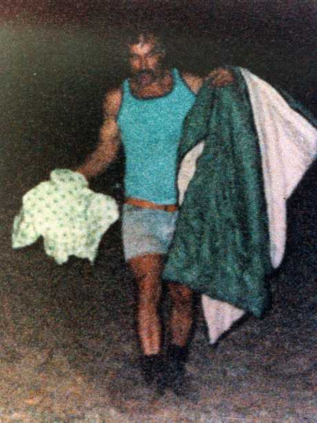Milat with a sleeping bag belonging to one of his victims.