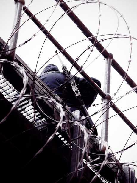 Prison officer on catwalk above Goulburn jail. Picture: Sam Ruttyn