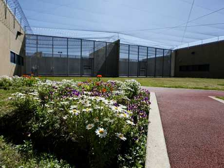 Flower bed and running track in the yard at Supermax prison where access to the outside is a privilege earned by good behaviour.