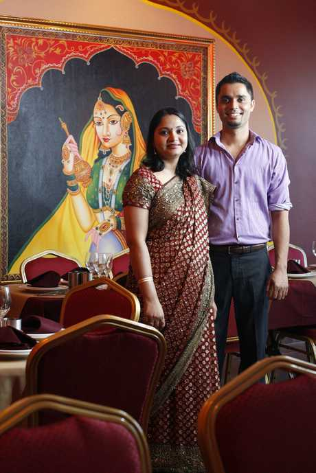 Deepti and Monish Pathak stand in the dining area of their new Indian restaurant The Punjab Curry Club on the corner of Limestone and Thorn Streets in Ipswich. Photo: Claudia Baxter / The Queensland Times