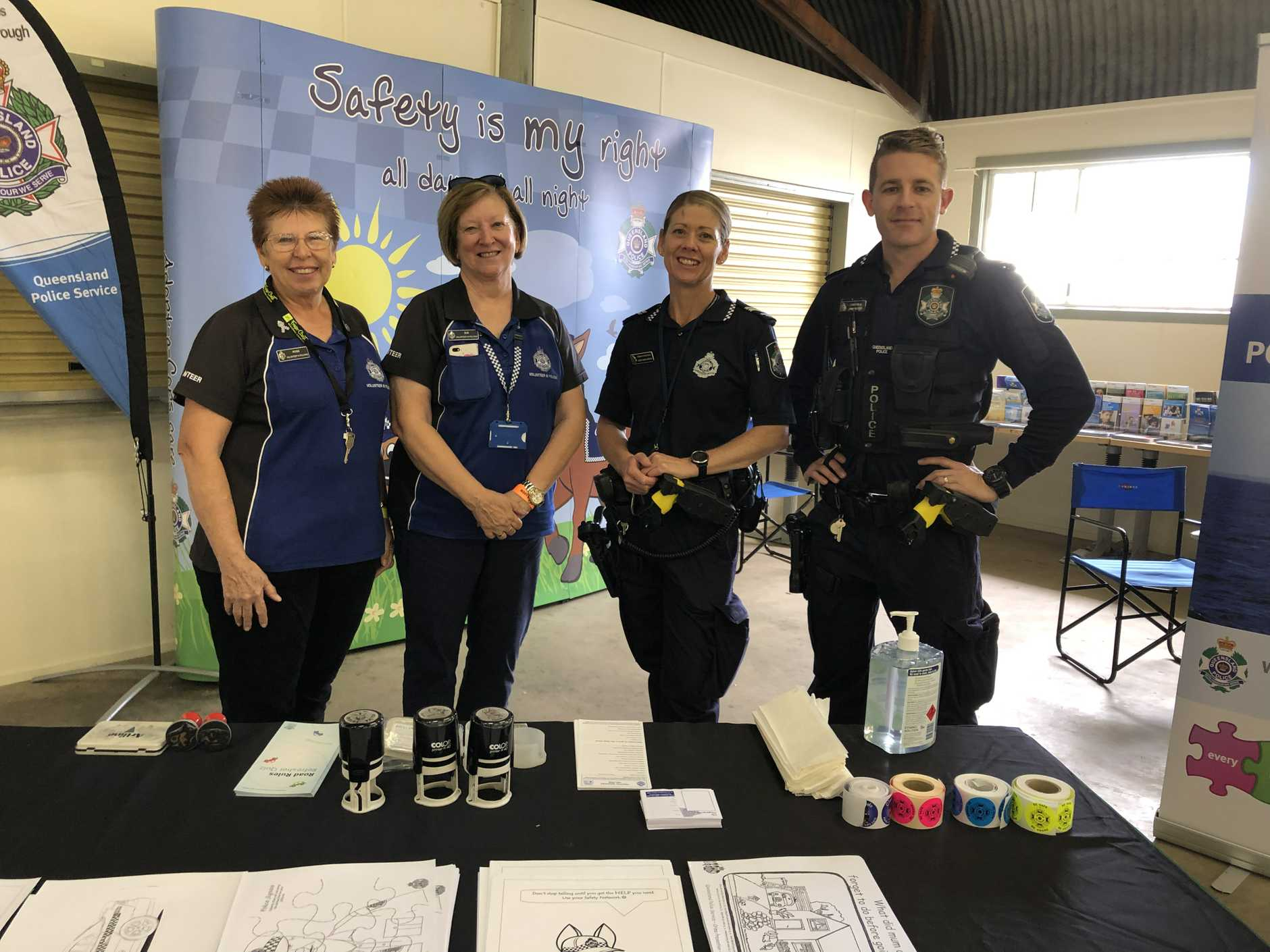 Volunteers Rose Tsakisiris and Sue Scheiwe with Senior Constable Leigh Nancarrow and Constable Jimmy Morris at their crime prevention stall at the Fraser Coast Show.