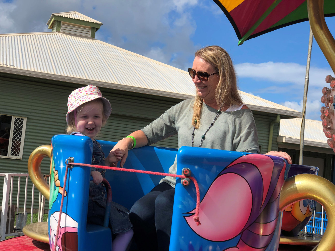Deb Mallane and her daughter Evie Mallane-Gallagher enjoyed a spin on the teacup ride at the Fraser Coast Show.