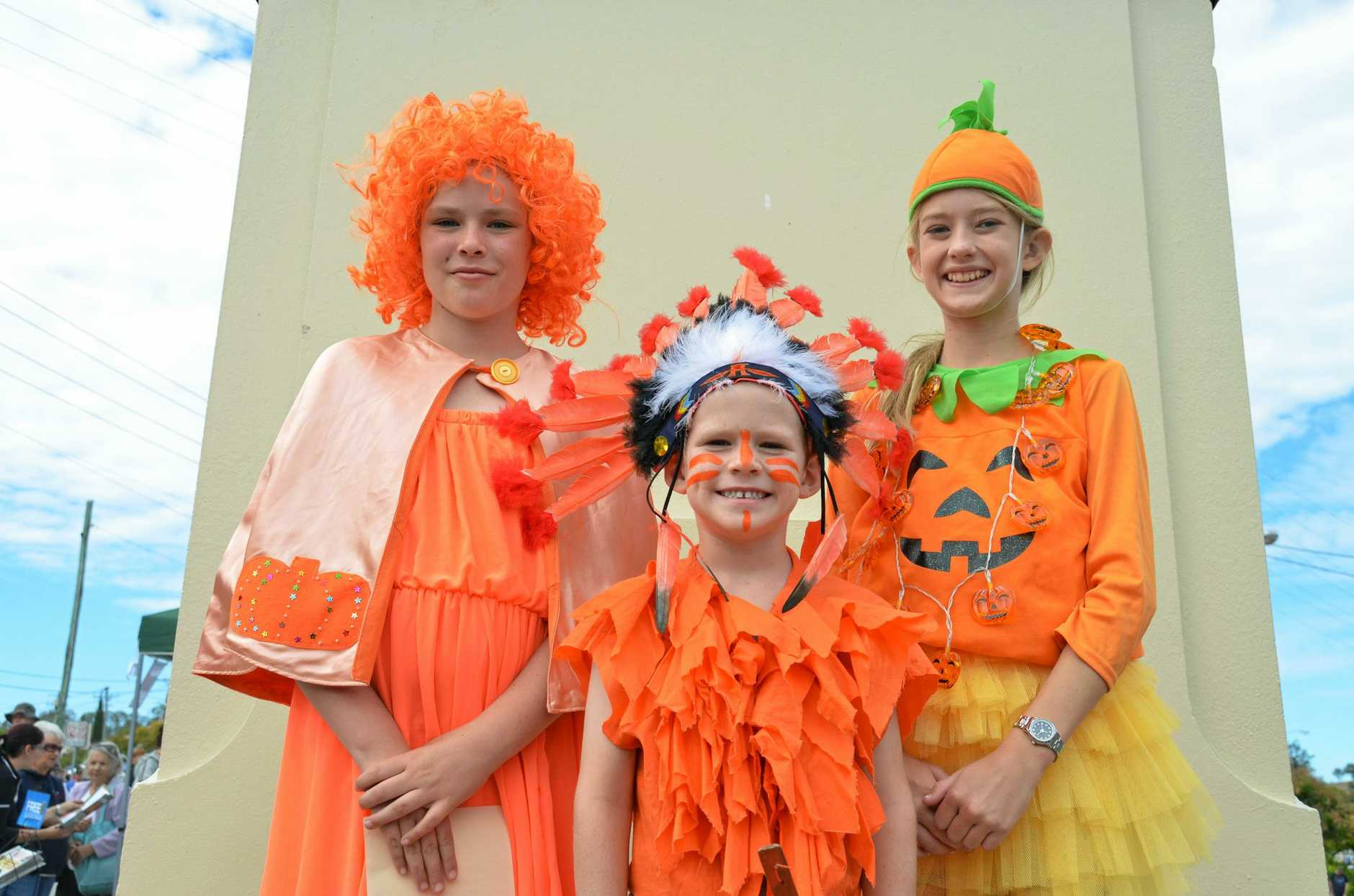 Maddison Richards, Eli Richards and Renee Gillard in their best and brightest pumpkin outfits at the Goomeri Pumpkin Festival on May 29, 2016.