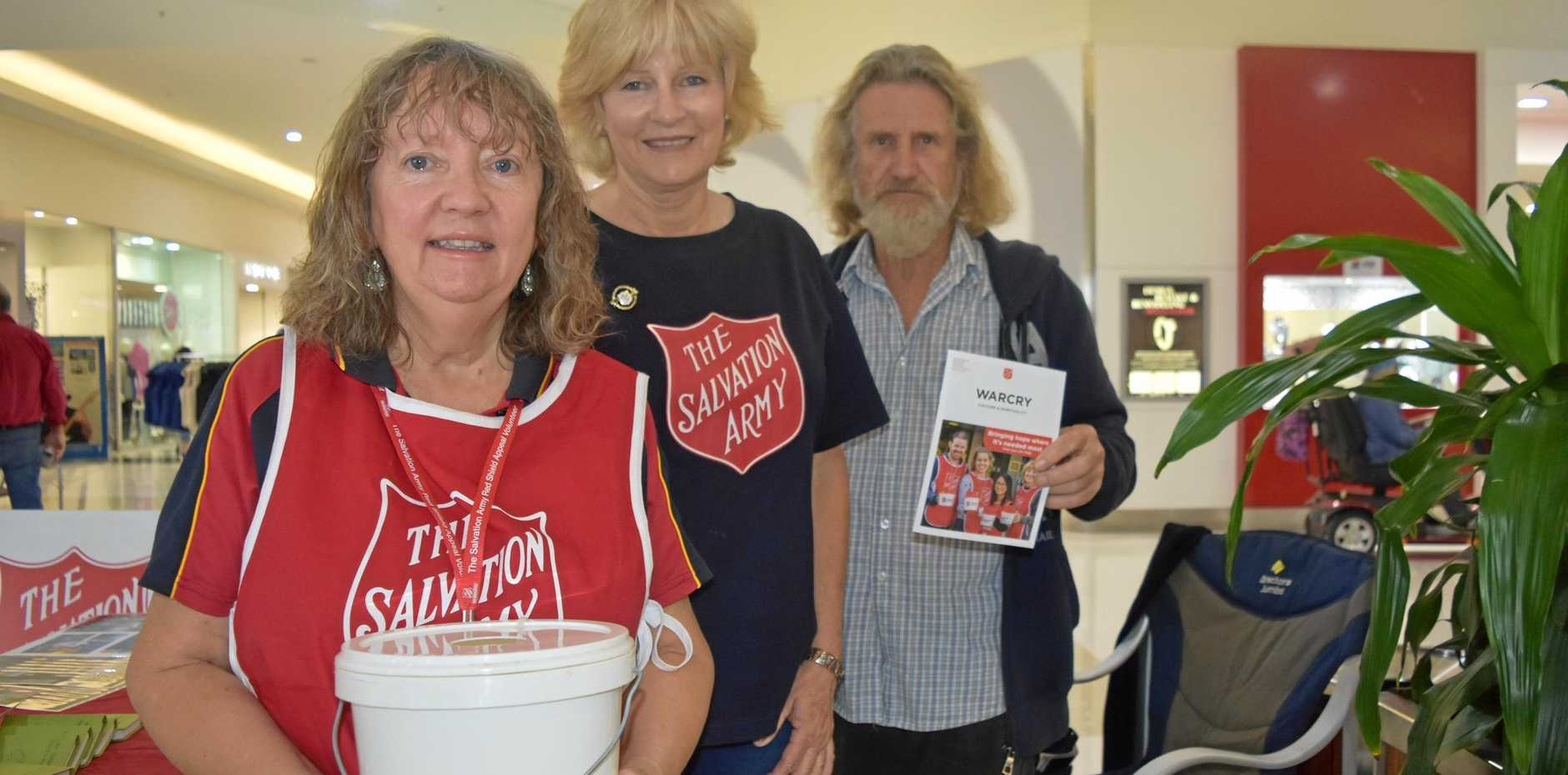 PAINTING DALBY RED: Salvation Army collectors Phyllis Wood, Christine Brooks, and Allan Wood have set up shop at Dalby Shoppingworld.