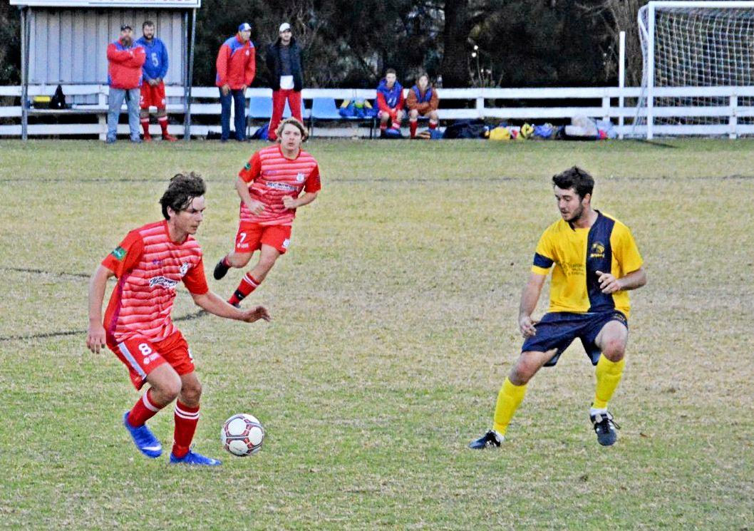 STRONG BOUT: Ballandean's Rob Coelli attempts to evade Inter's Jordan Lanza in their men's tie on Saturday afternoon.