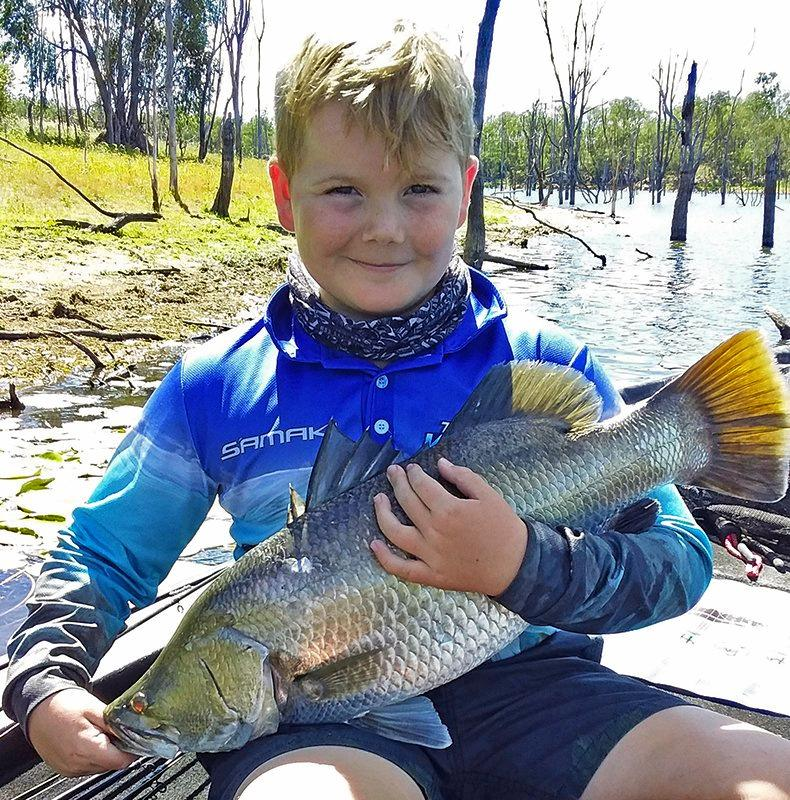 Parker Spittal, who has been putting in a big effort of late learning the tactics about lures , line and leaders, with one of a number of barramundi he caught at Lake Monduran.