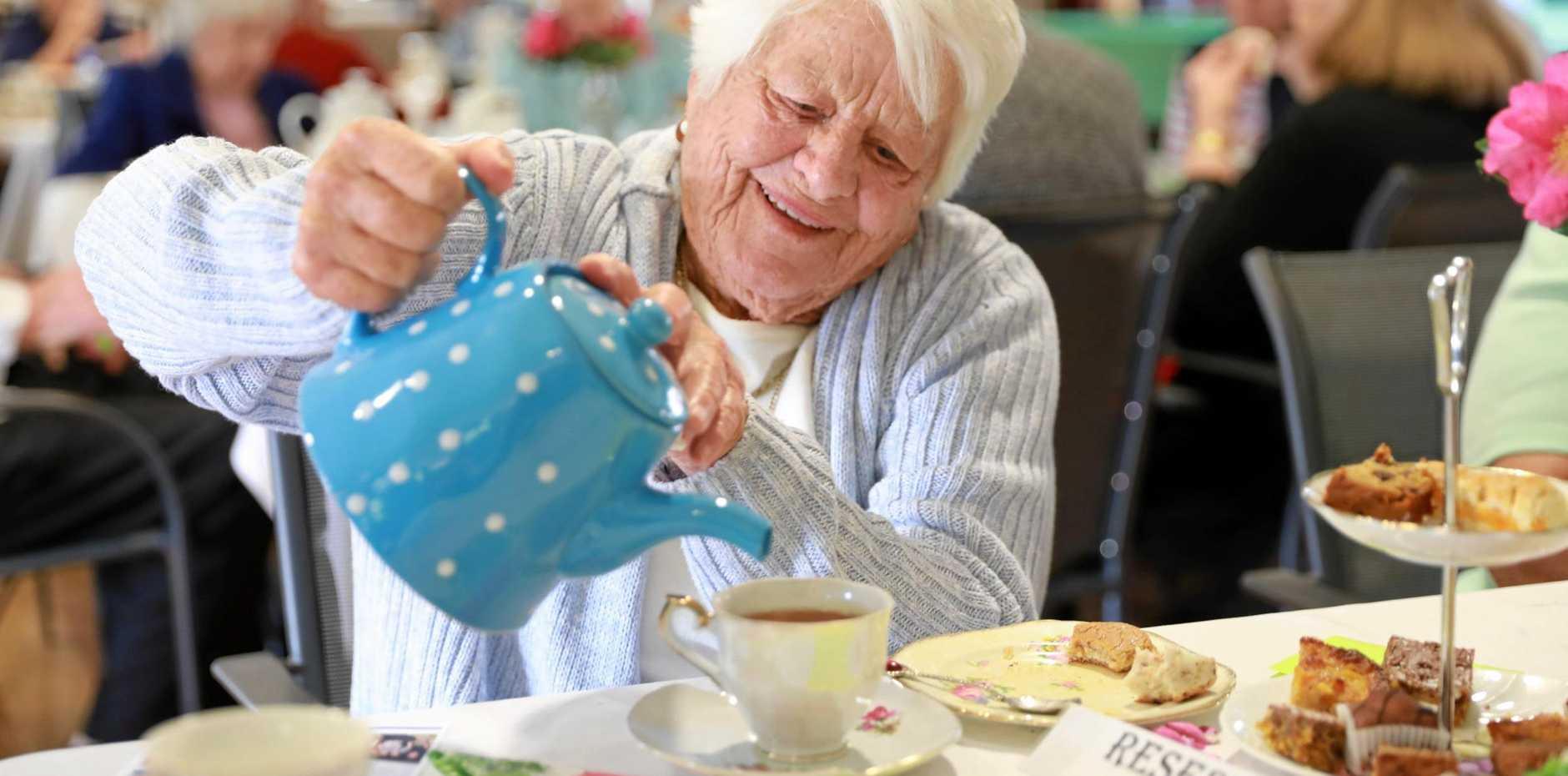 Jewells Lifestyle Community friend Carmel Johnson enjoys a cuppa at the village's Biggest Morning Tea fundraiser.