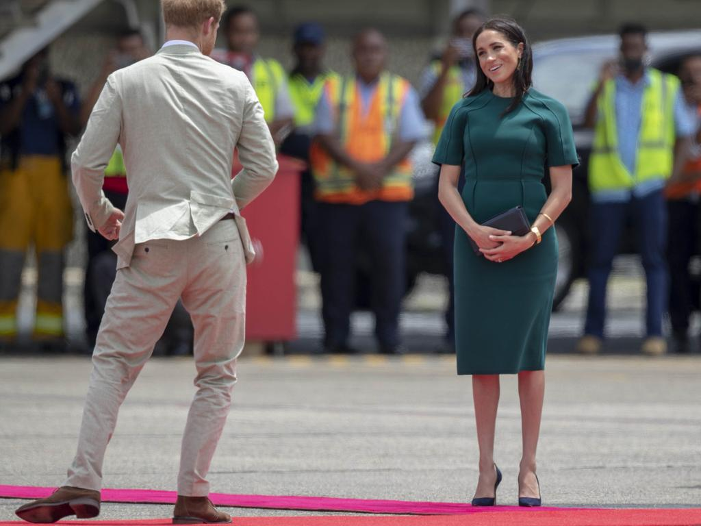 Leaving Fiji in a green dress by American designer Jason Wu. Picture: Ian Vogler/Pool Photo via AP