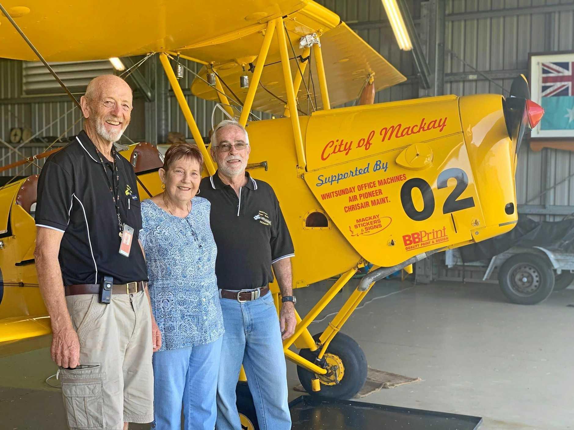 Secretary and volunteer enthusiast Bob Baden, promotions officer Carolyn Ward and pilot Greg Christensen at the Mackay Tiger Moth Museum.