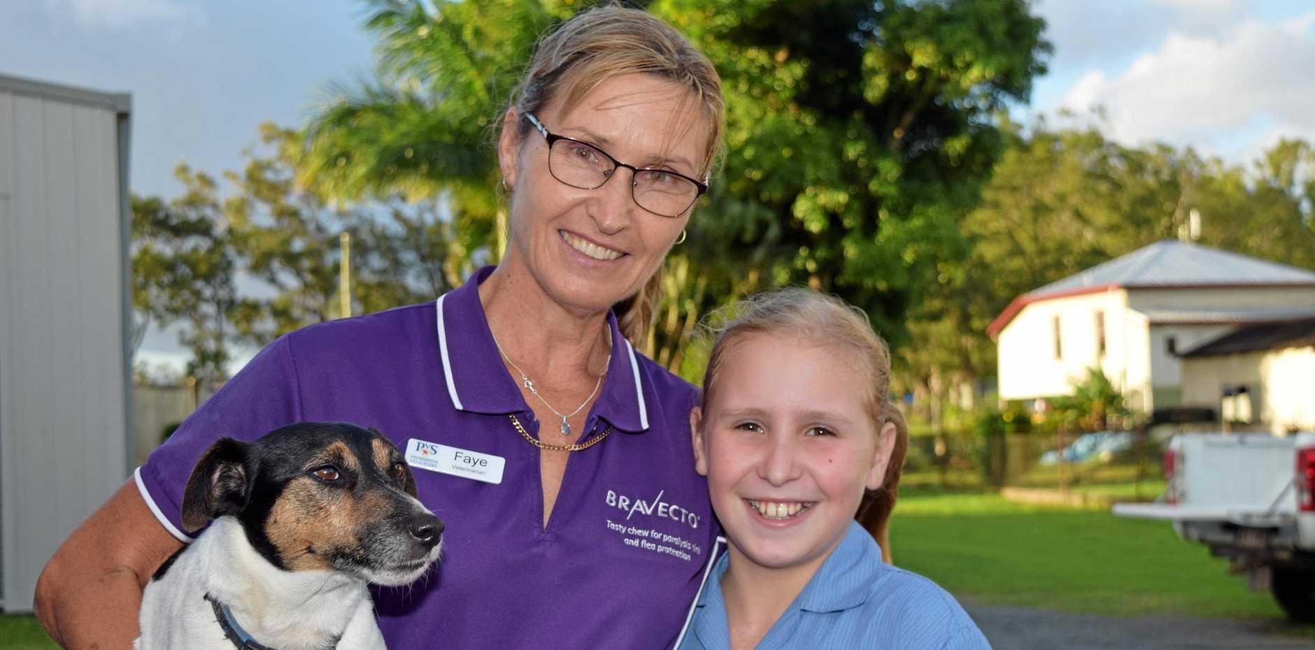 Faye Elder and Karli Elder, with family dog Spotty.