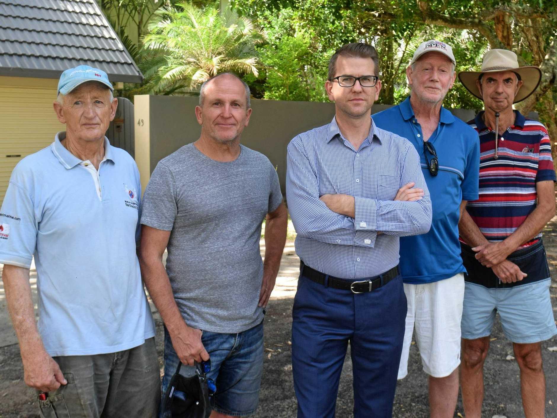 Kawana MP Jarrod Bleijie met with angry Currimundi locals Earle Alexander, Greg Hindmarsh, Peter Ruffle and Richard Freeman.