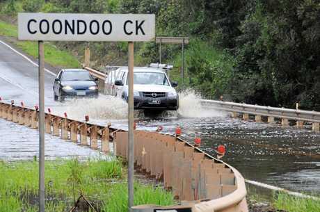 Water over the Coondoo Creek Bridge.