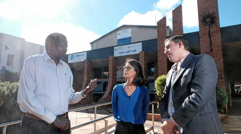 FUNDS NEEDED: Settlement worker Akol Mager (left) chats with CatholicCare Social Services Toowoomba director Kate Venables and bicultural worker Yousef Roumieh.