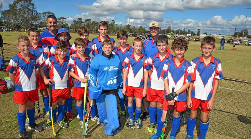 READY FOR ACTION: Warwick under-13 boys hockey team (front, from left) Harry Newton, Jack Scarlett, Lachlan Bruton, goalie James Bourke, Liam Poole, Lachlan Nolan, Tom Ryan, Levi Rhodes, (back) Tanner Henley, manager Ross Newton, Sam Bourke, Eamon Walsh, Bryce Zerner, Tiger Windle, coach Craig Windle.