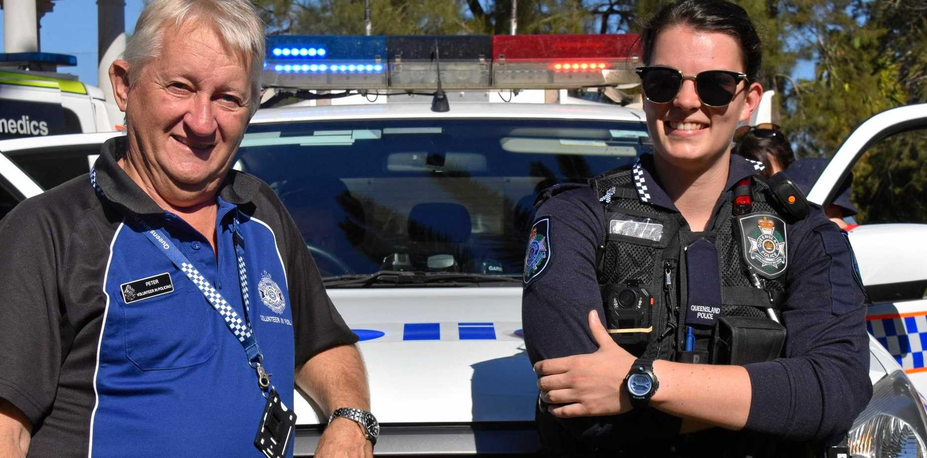 BIG HELP: Peter Verbakel who is a volunteer in policing, with Kingaroy Constable Bethany Rogerson.