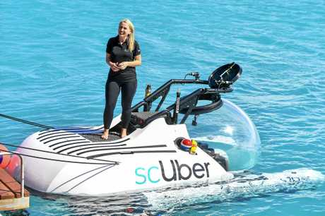 Minister for innovation, tourism industry development and the commonwealth games Kate Jones at the launch of ScUber, the first ride sharing submarine launched at Heron Island.