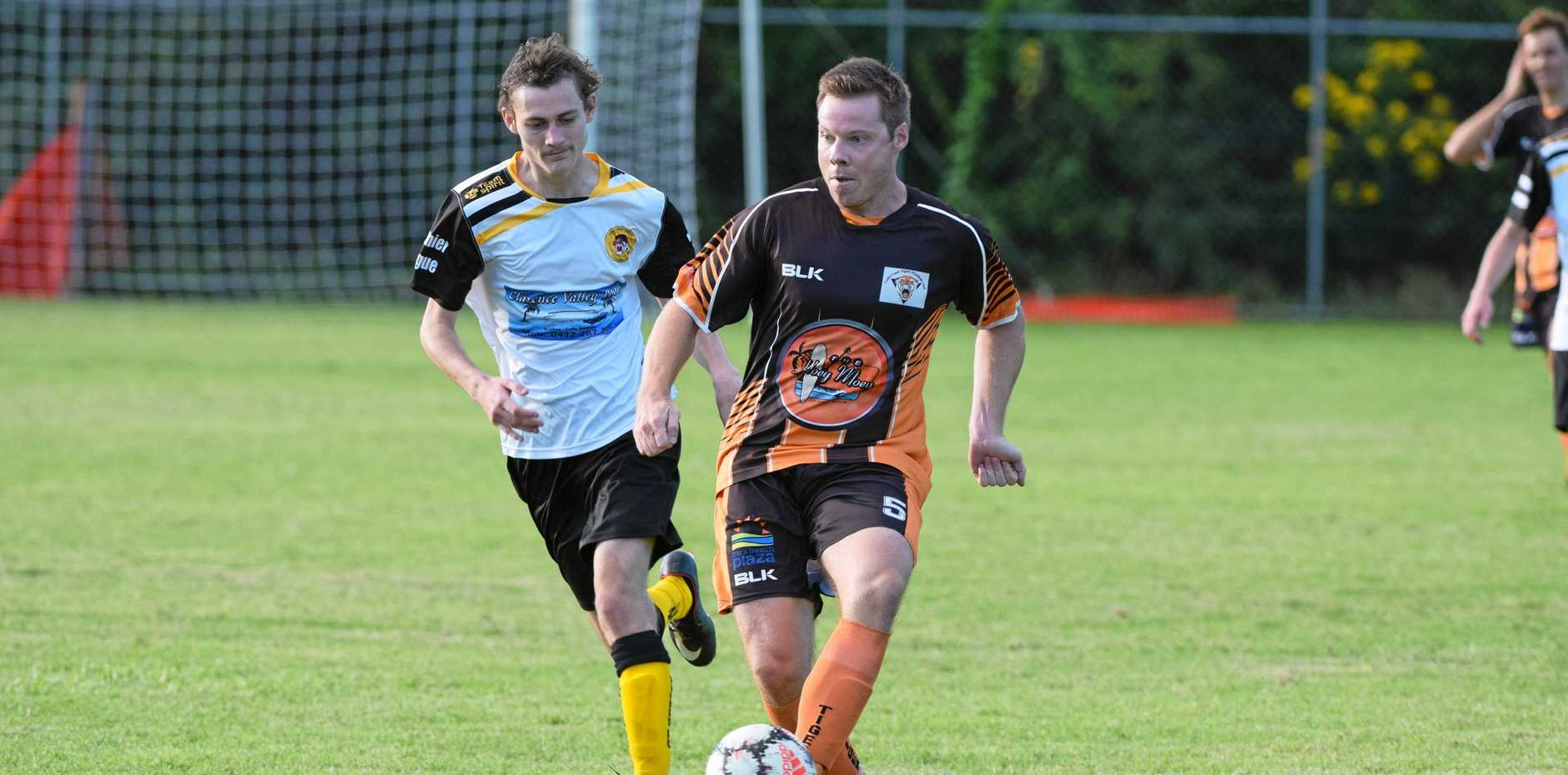 BIG GAME: Coffs Coast Tigers left back Trent Lakeman plays out from the back. Lakeman and his teammates will try and bring down the Coffs City United Lions tomorrow.