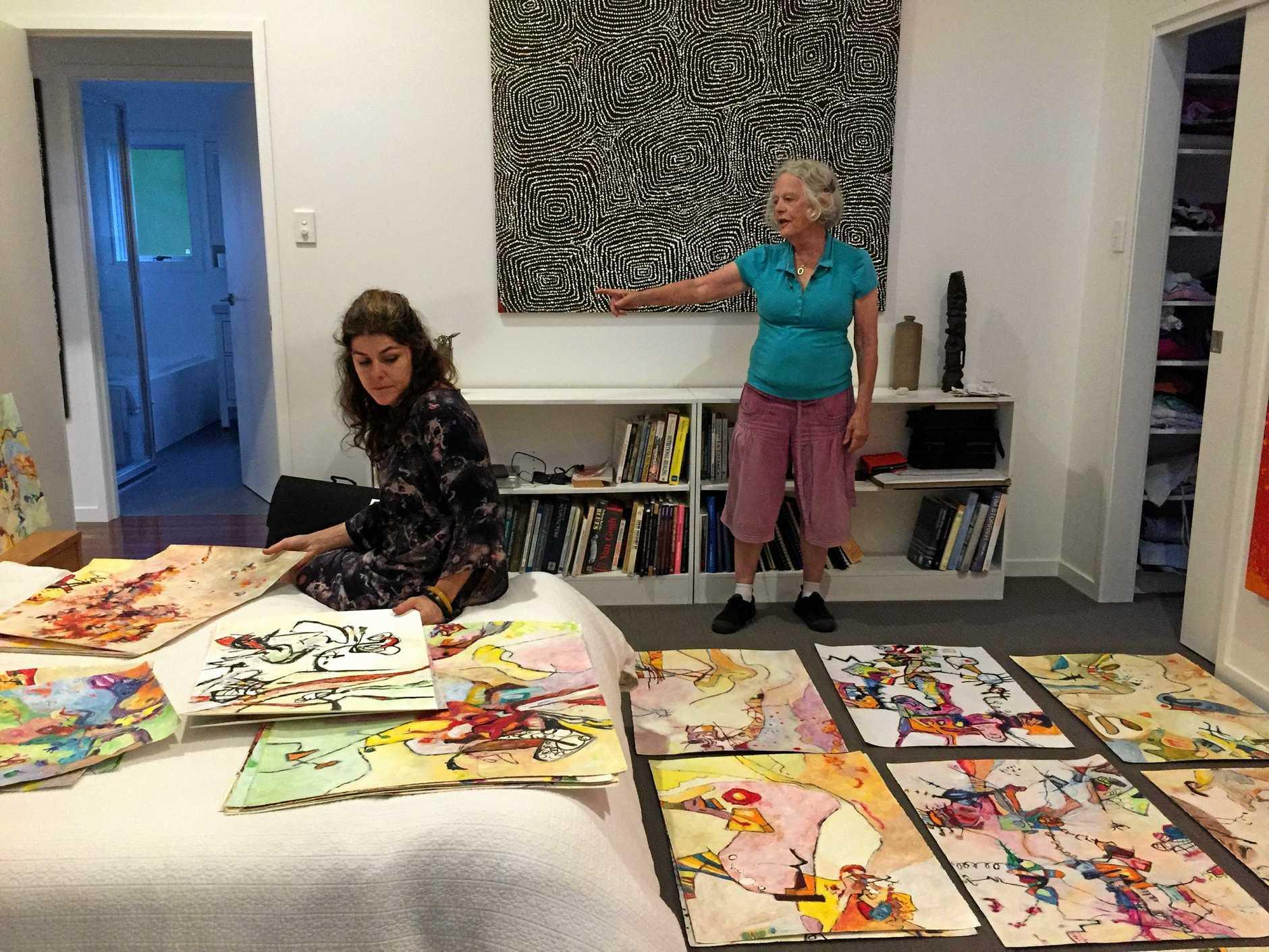 Artist Margaret Builder and Butter Factory Arts Centre coordinator Alicia Sharples consider exhibition options.
