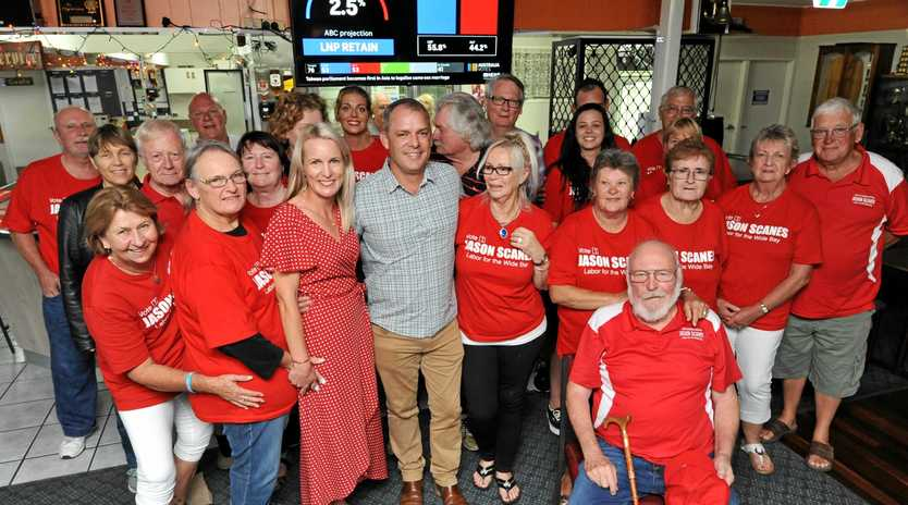 FEDERAL ELECTION: ALP Wide Bay Labor candidate Jason Scanes with wife Jackie and supporters at the Maryborough Services Memorial Bowls Club.