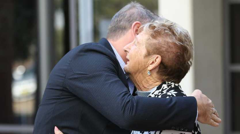 Steve Sibraa and Marion Smith comfort each other outside court after Valentine was sentenced. Picture: John Grainger