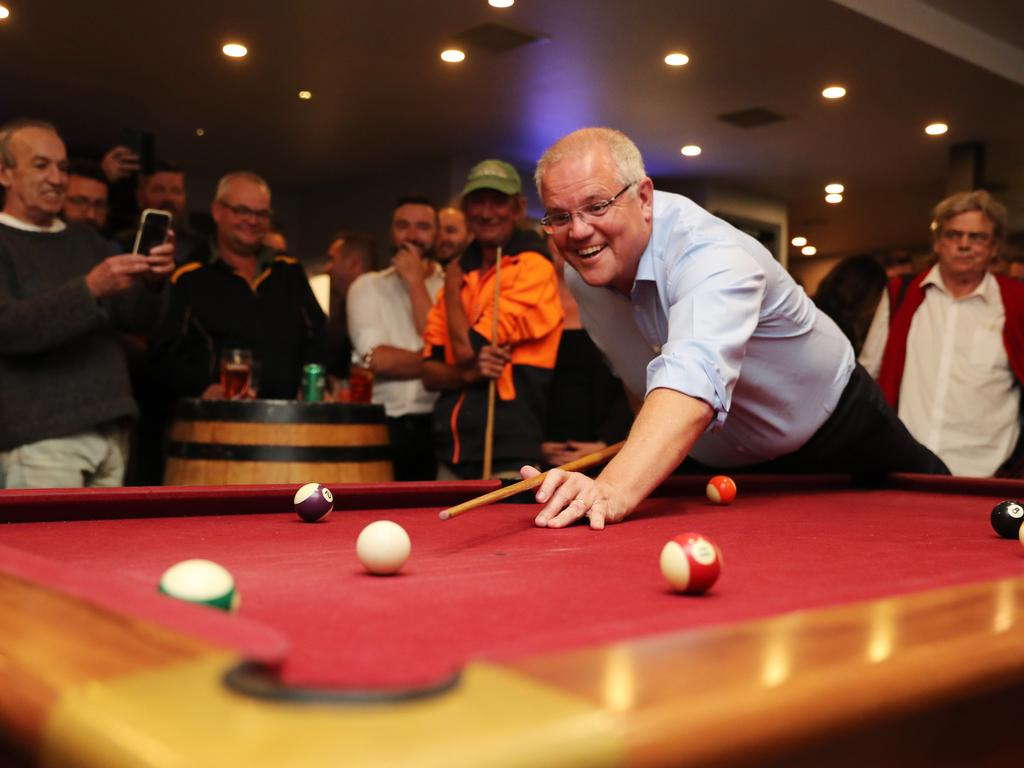Morrison plays pool at a pub in Launceston and meets and greets the locals. Picture: Adam Taylor