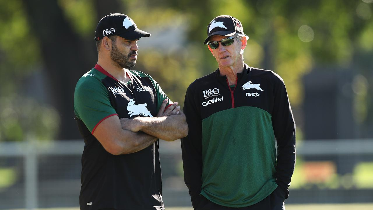 Greg Inglis and coach Wayne Bennett chew the fat during a South Sydney training session at Redfern Oval. Picture: Brett Costello.