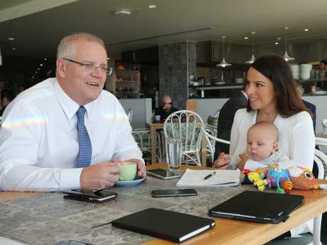 Sharri Markson interviews Scott Morrison during the federal election campaign while holding her baby Raphi. Picture: Adam Taylor