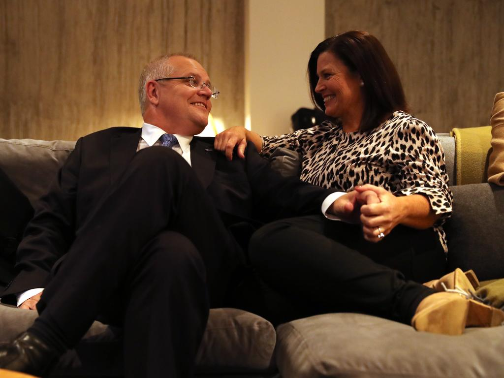 Scott Morrison with his wife Jenny on their couch in the hotel in Launceston during the last week of the election campaign. Picture: Adam Taylor