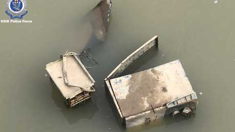 The partly submerged ATM stolen from Moama