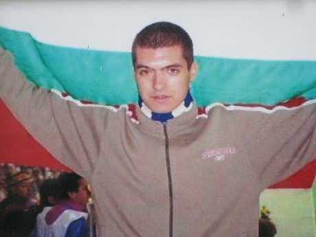 Andrei Monov holding up Bulgarian national flag at a soccer match. Picture: Supplied