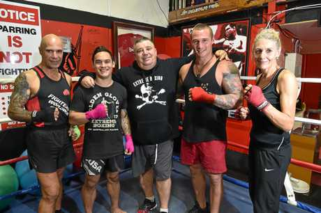 FIGHTING FOR CHANGE: Boxing trainer Kim Gray (centre) with his boxing family Hemi Niha, Cody Cole, Scott Kelly and Keena Hull.