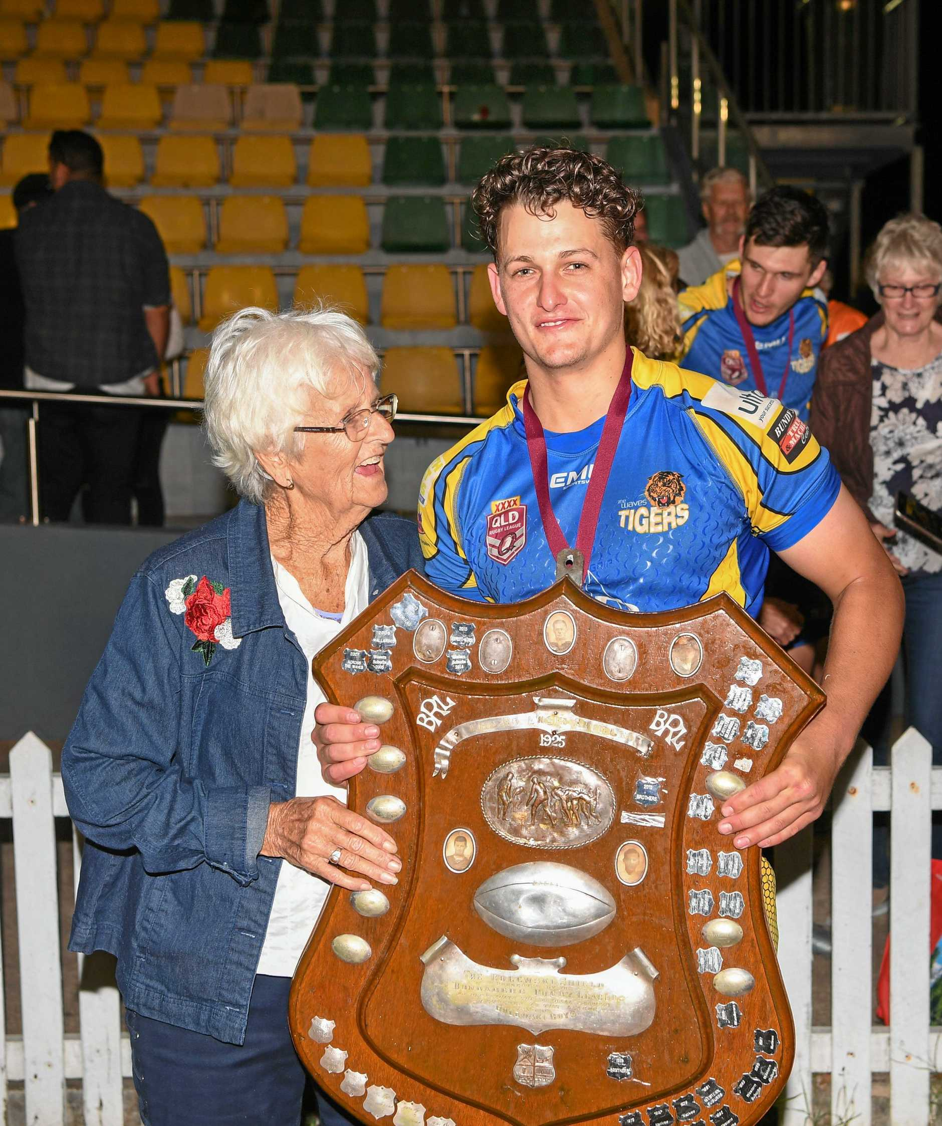 Dan McLennan with his grandmother after The Waves won last year's grand final.