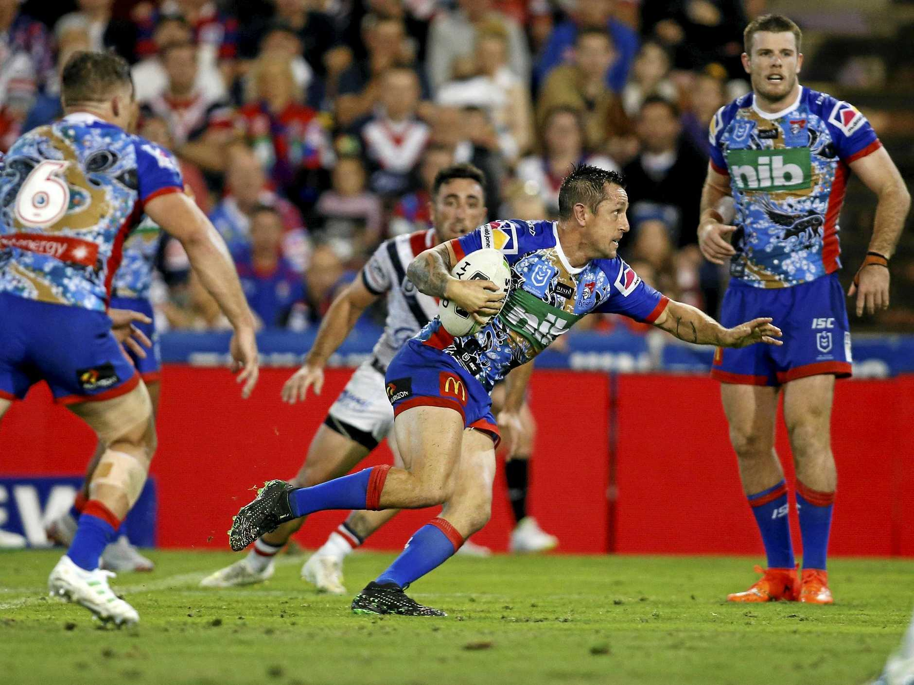 Mitchell Pearce attacks on Friday night in the Knights' clash with the Sydney Roosters at McDonald Jones Stadium, Newcastle.  Picture: Darren Pateman/AAP