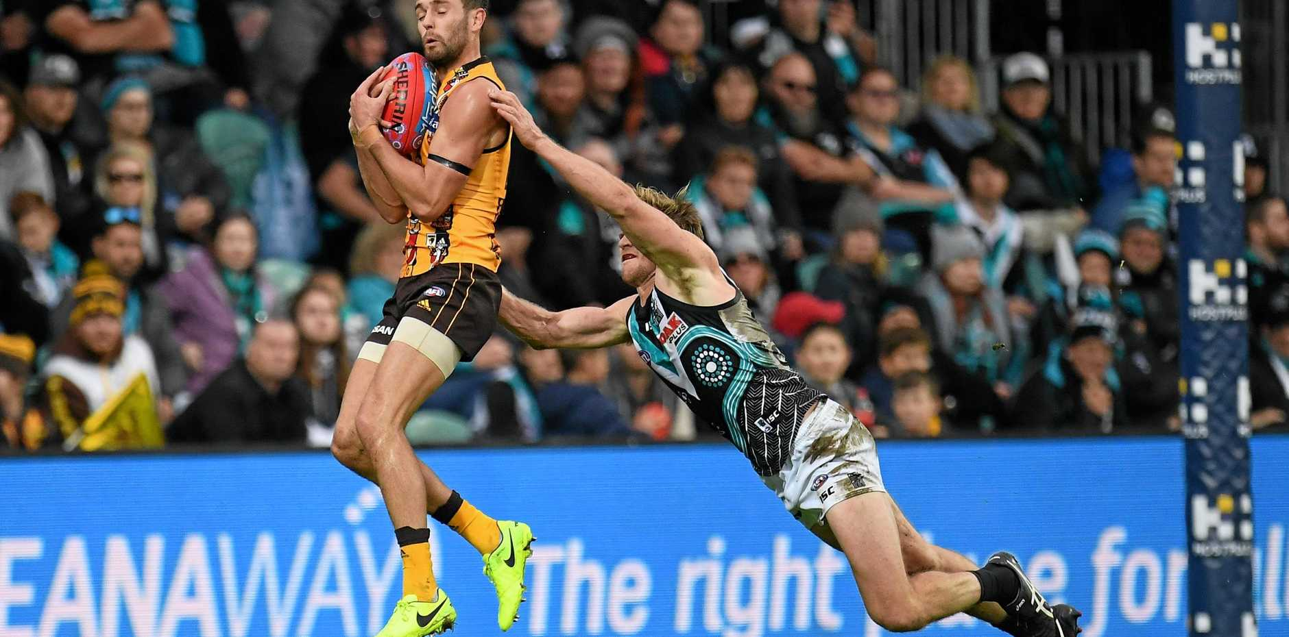 Hawthorn's Jack Gunston marks in front of Port Adelaide's Tom Jonas at the University of Tasmania Stadium, Launceston on Saturday. Picture: Julian Smith/AAP