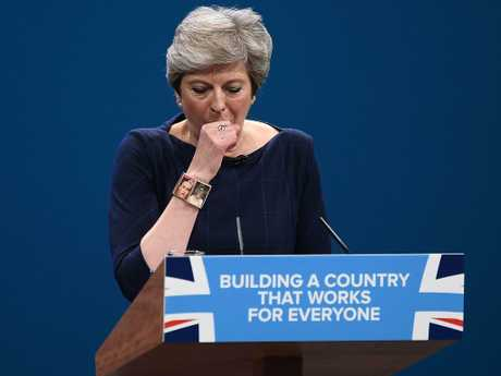 Theresa May has struggled with a bad cough during a speech about the voiceless, at the Conservative Party Conference in 2017. Picture: Getty Images