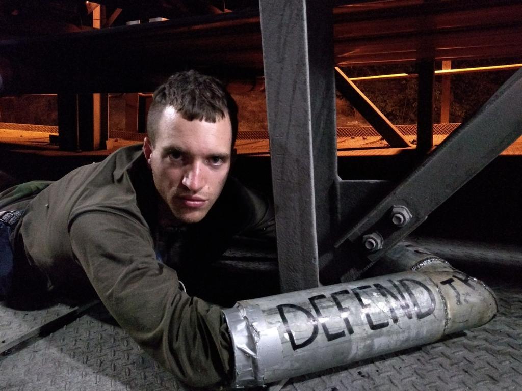 Nic Avery locks himself to machinery at Adani's Abbot Point coal terminal.