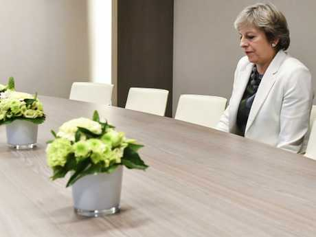 British Prime Minister Theresa May waits for the arrival of European Council President Donald Tusk during an EU summit in Brussels. Picture: AP Photo/Geert Vanden Wijngaert, Pool