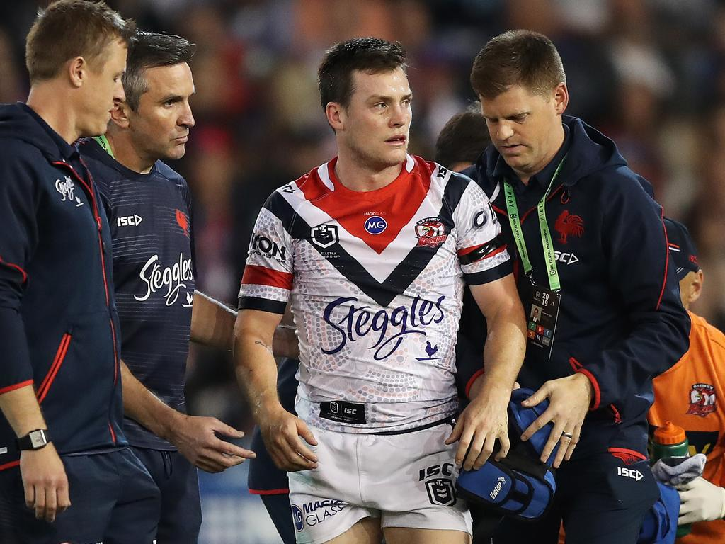 The Roosters' Luke Keary leaves the field after a head knock on Friday night. Picture: Brett Costello