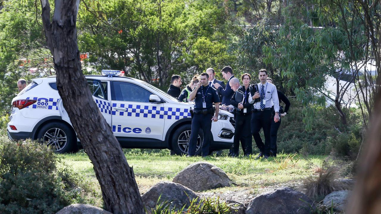 Police have swarmed on a inner-city park in Melbourne after a woman's body was found near tennis courts. Picture: Tim Carrafa