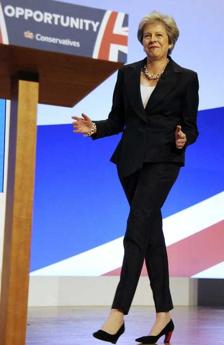 Theresa May dances as she arrives on stage to address delegates during a speech at the Conservative Party Conference at the ICC, in Birmingham, England. Picture: AP Photo
