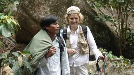 Annette at the crash site in 2006 with Mr Cao, the police officer who found her in the jungle.